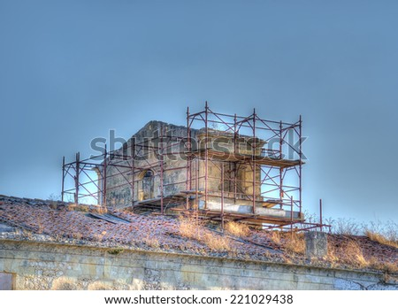 old building with metal scaffolding - stock photo