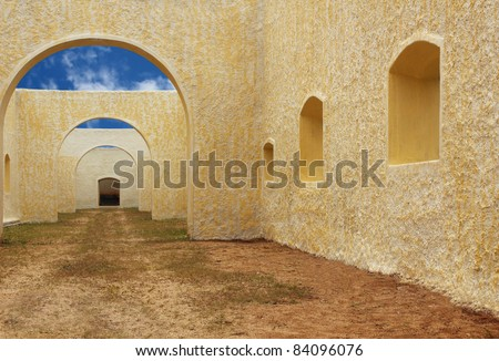 Old building with open top showing bright sky in the backdrop - stock photo
