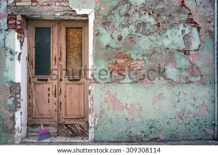 Old building with vintage of entrance door in European city - stock photo