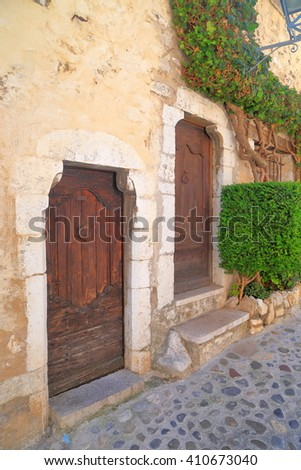 Old building with wooden door from the medieval town of Saint Paul De Vence, France