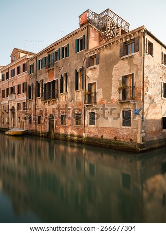 Old Buildings along the Venetian Lagoon in Venice during the day - stock photo