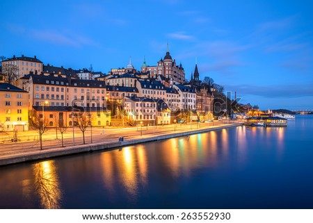 Old buildings and pier in Stockholm, Sweden at dawn - stock photo