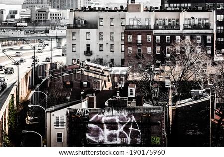 Old buildings and the Delaware Expressway, seen from the Ben Franklin Bridge Walkway in Philadelphia, Pennsylvania. - stock photo