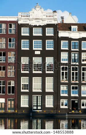 Old buildings at the canal in Amsterdam - stock photo