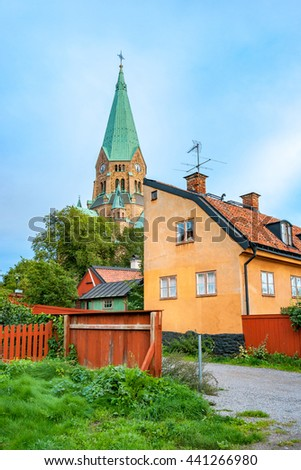 Old buildings at Vita Bergen with a Sofia church in the background. Sodermalm, Stockholm, Sweden - stock photo