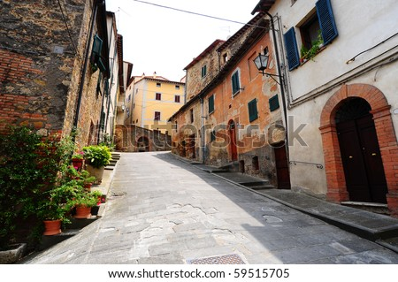Old Buildings In Typical  Medieval Italian City - stock photo