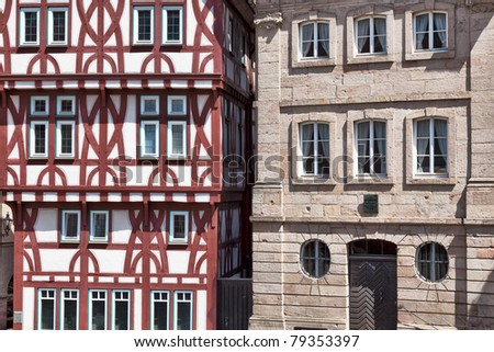 Old buildings on the Stiftsplatz in the heart of the historical old town of Aschaffenburg, Bavaria, Germany.