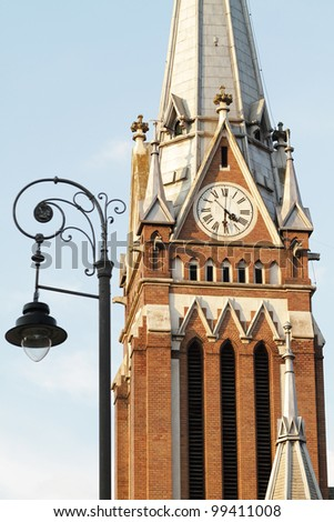 Old buildings tower with clock close up - stock photo