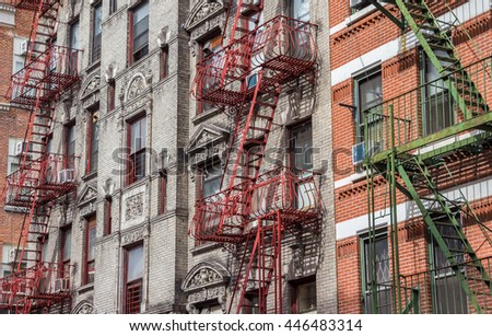Old buildings with fire stairs in New York City, USA - stock photo