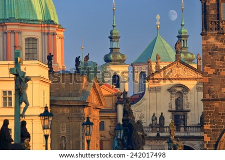 Old buildings with Gothic and Baroque architecture seen from the Charles bridge at evening, Prague, Czech Republic - stock photo