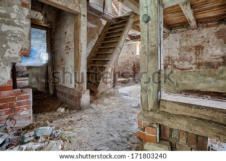Old, built of wood and brick, abandoned barn - stock photo