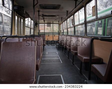 Old bus interior - stock photo