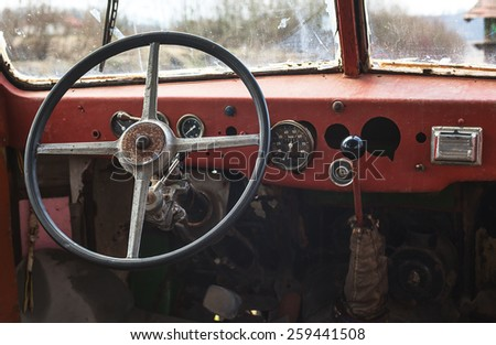 Old bus interior, view on steering wheel and control table.
