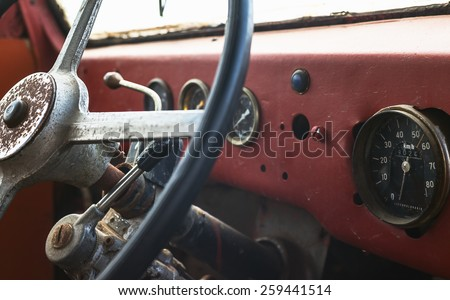 Old bus interior, view on steering wheel and control table.  - stock photo