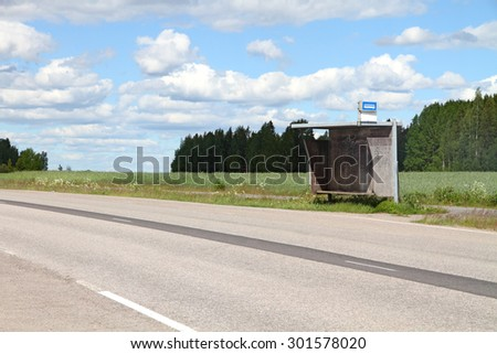 Old bus stop in countryside  - stock photo