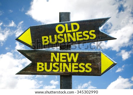 Old Business - New Business signpost with sky background