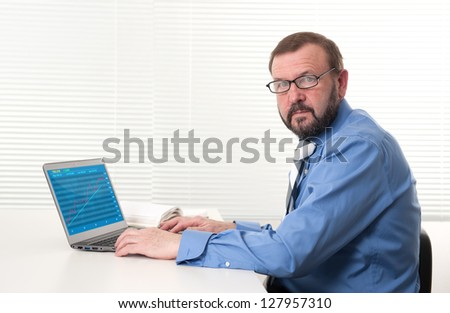 old businessman with laptop - stock photo