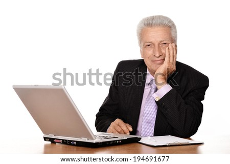 Old businessman working with notebook isolated on a white background