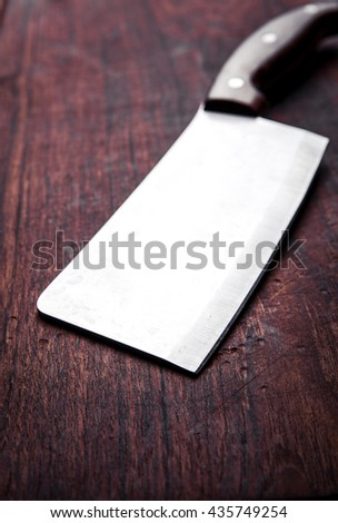 Old butcher knife, on wooden background. Kitchen, cooking. - stock photo