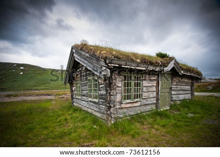 Old cabin in the mountains of Norway. - stock photo