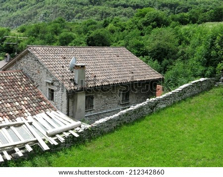 Old cabin stone hamlet chalet cottage shack, Italy. - stock photo