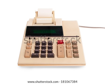Old calculator for doing office related work, isolated in white - stock photo
