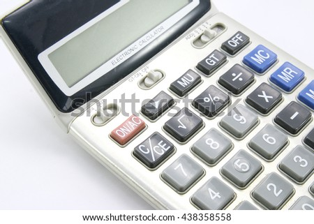 Old calculator on white background - stock photo