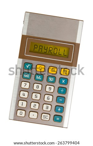 Old calculator showing a text on display - payroll - stock photo