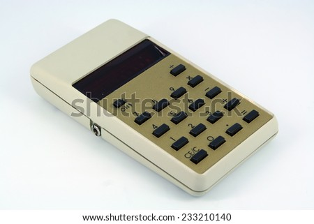 Old calculator tool. Vintage calculator. - stock photo