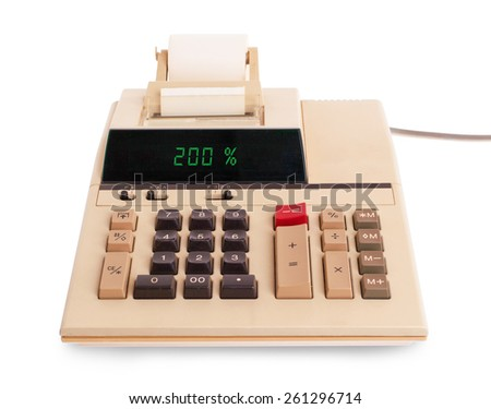 Old calculator with digital display showing a percentage - 200 percent - stock photo
