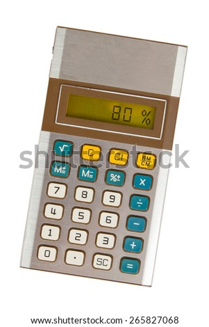 Old calculator with digital display showing a percentage - 80 percent - stock photo