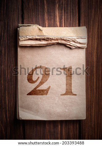 Old calendar on a wooden background - stock photo