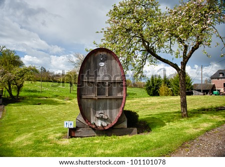 old calvados barrel next to an apple tree