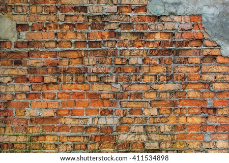 Old, came down the wall of red brick. - stock photo