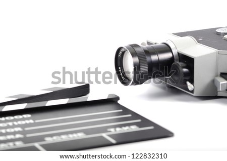Old camera and movie clapper board, isolated , movie industry concept - stock photo