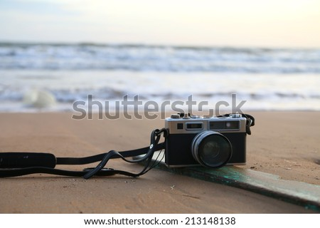 old camera and the sea - stock photo