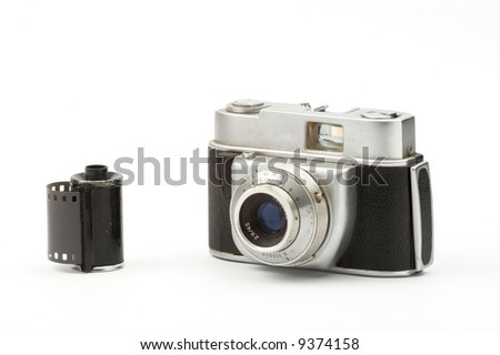 Old camera over white background