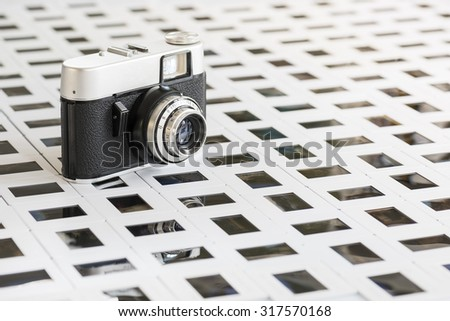 old camera resting on floor of slide - stock photo