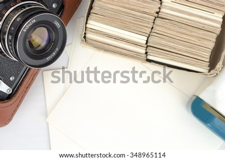 Old camera with photo slides and old pictures templates - stock photo