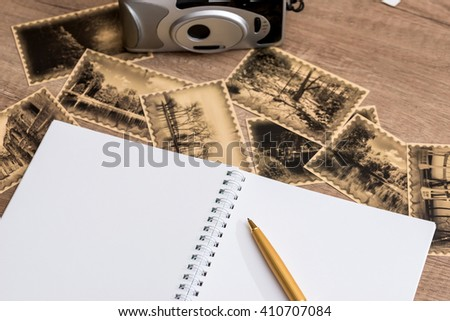 old camera with photos and pad - stock photo