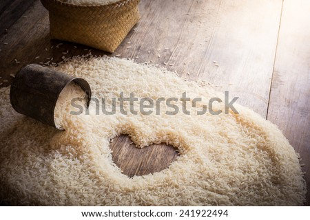 old can and rice background Space in the middle of a heart. sackcloth is background - stock photo