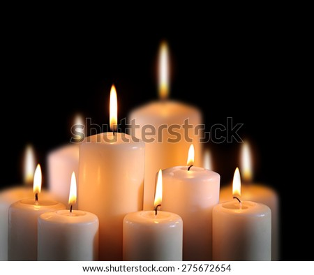 old candle on the black background  - stock photo