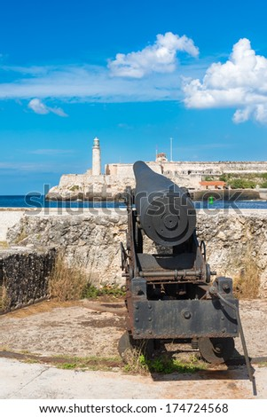 Old cannon aiming at the famous fortress of El Morro in Old Havana - stock photo