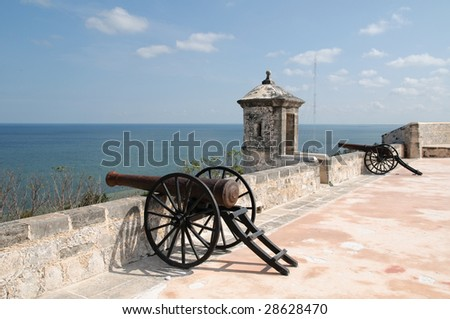 Old cannon from the rooftop of a fort in Campeche