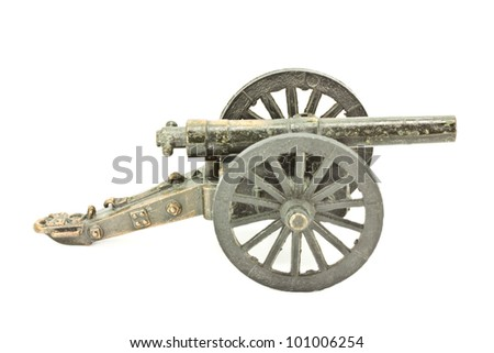 Old cannon model on a white background.