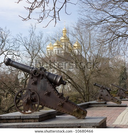Old cannon's in Chernigov. On background park and cossack's church.