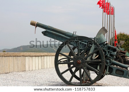 Old cannon with flags, in a turkish monument