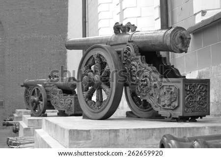Old cannons in Moscow Kremlin, a popular touristic landmark. UNESCO World Heritage Site. Black and white photo