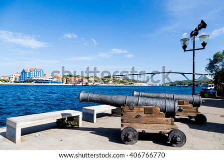 Old cannons on walkway in Curacao - stock photo