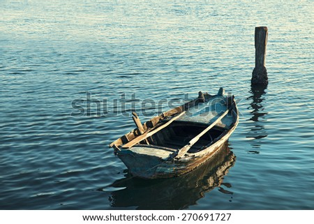 Old Canoe floating on the calm water